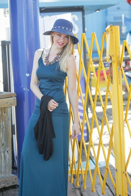 Teal Tank Set By The Pier