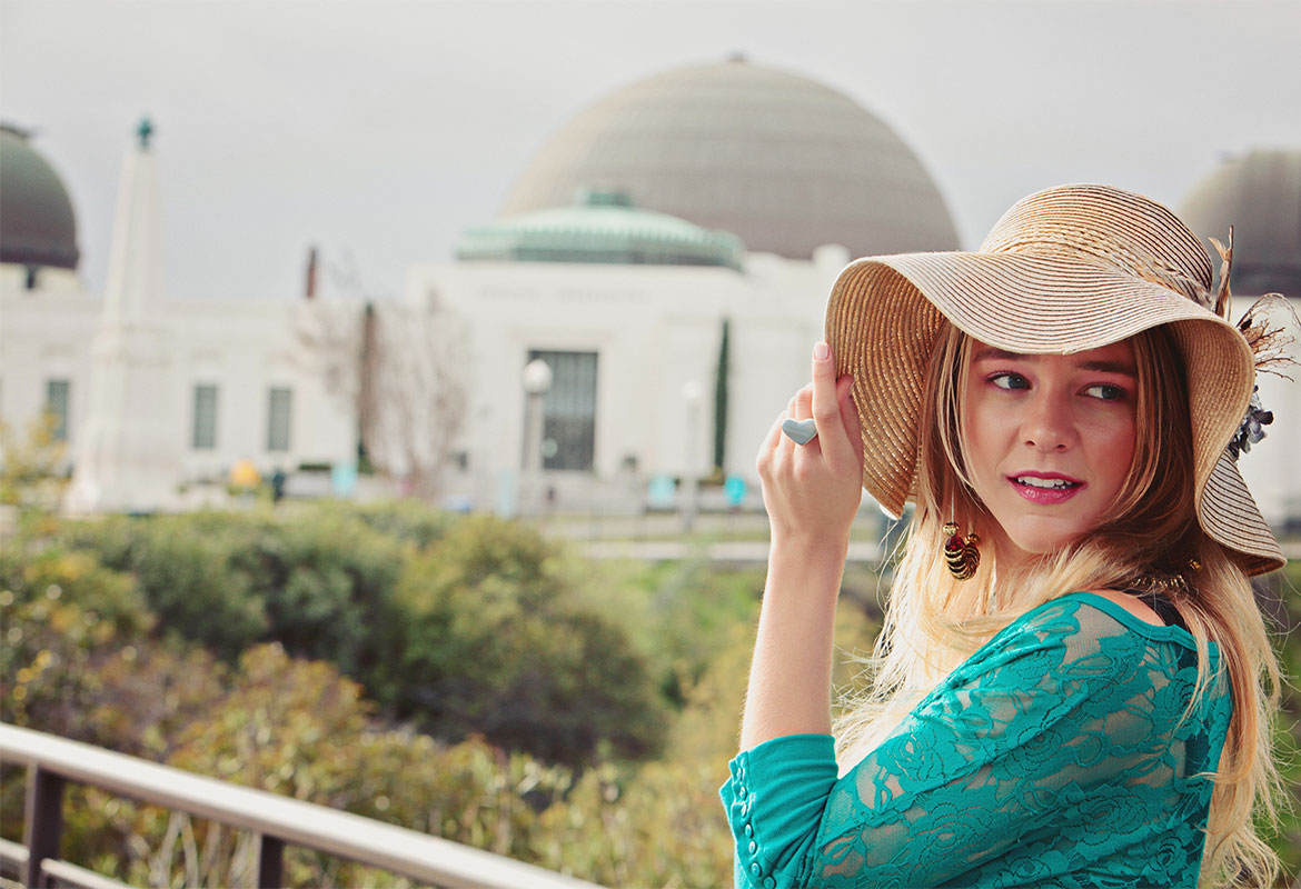 Model in Turquoise Top and Tan Hat
